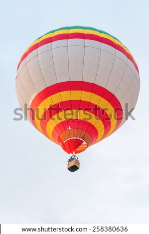 White Red Yellow Hot Air Balloons in Flight. Outdoor, Colorful / Colorful hot air balloon in blue sky. White Red Yellow  aerostat - stock photo