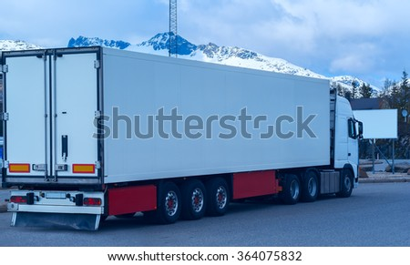 White refrigerated truck on background of the mountains - stock photo