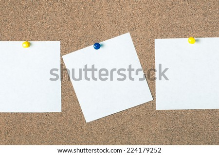 white reminder sticky note on cork board empty space for text - stock photo