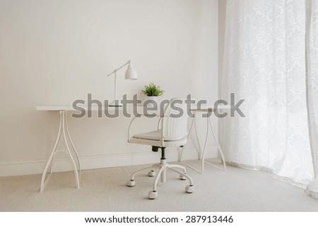 White retro desk in pure empty interior - stock photo