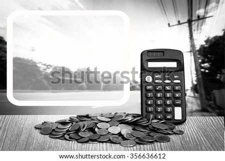 white reveal border on calculator on pile of coins with road and blue sky background - stock photo