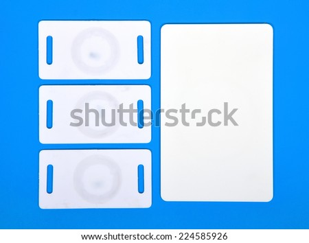 white RFID cards on a blue background - stock photo