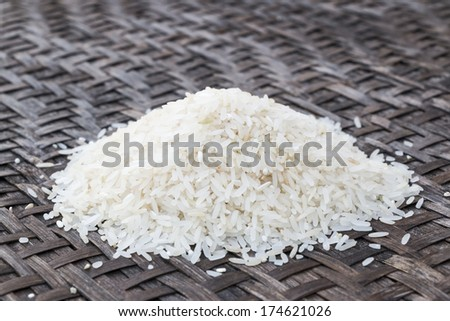White rice on bamboo wooden - stock photo