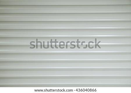 White roller shutter door background - stock photo