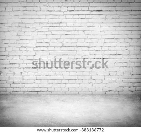 White room interior with brick wall and concrete floor