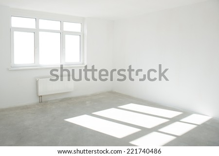 White room with window full of light - stock photo