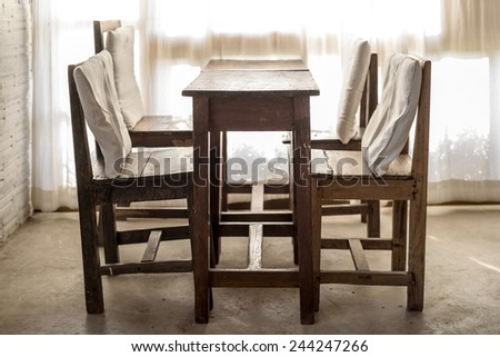 White room with wooden table and chair  , Vintage style - stock photo