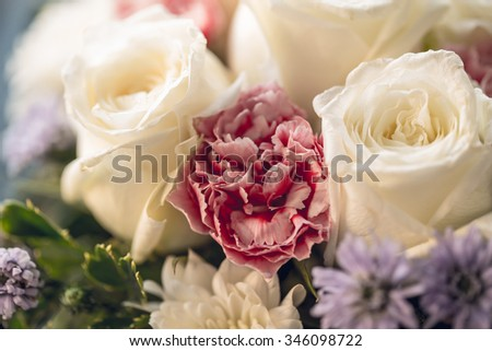 White Rose with Carnation vintage color tone. - stock photo