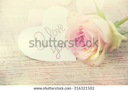 White rose with message card of love. - stock photo