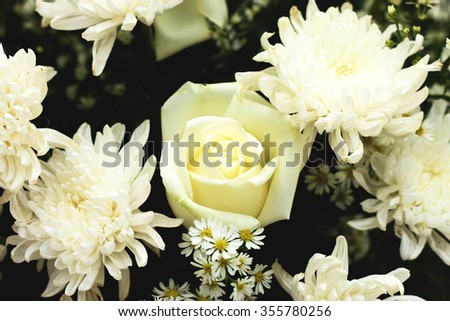 White roses and other flowers