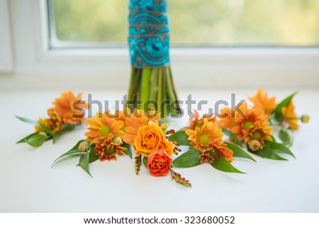 white roses groomsmen boutonniere and wooden background - stock photo