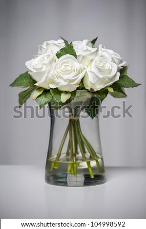 White roses in vase. - stock photo