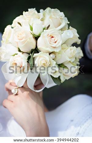 White roses wedding bouquet - stock photo