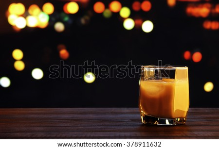 White russian cocktail on blurred bokeh background - stock photo