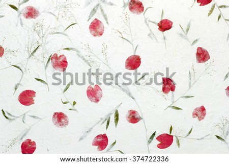 White Sa Paper with roses petals and flowers of grass  background, Sa Paper is hand made paper from parish Bosang province Chiang Mai north of Thailand, Mulberry paper texture background - stock photo