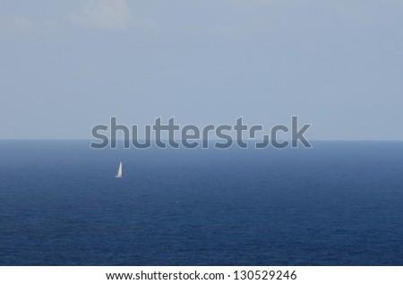 white sailboat at the mediterranean sea - stock photo
