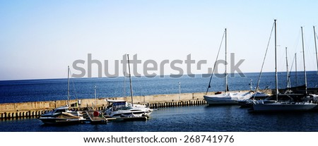 White sailing boats in port. - stock photo
