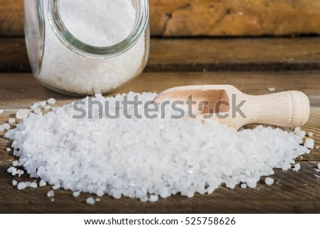 White salt in a jar on a wooden background