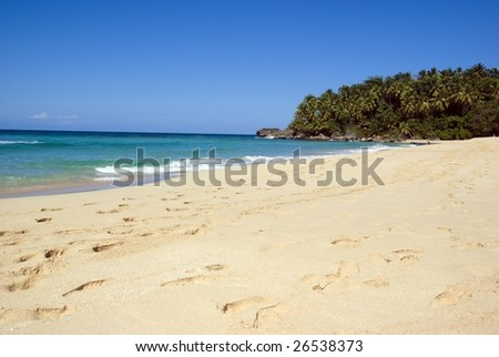 white sand beach and blue water - stock photo