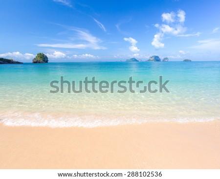 White sand beach and tropical sea - stock photo