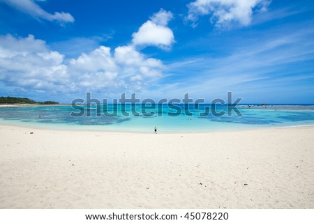 White sand beach with clear blue water of Japanese subtropical islands - stock photo