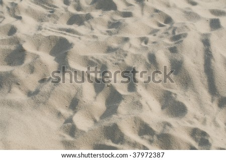 white sand with vague footprints - stock photo