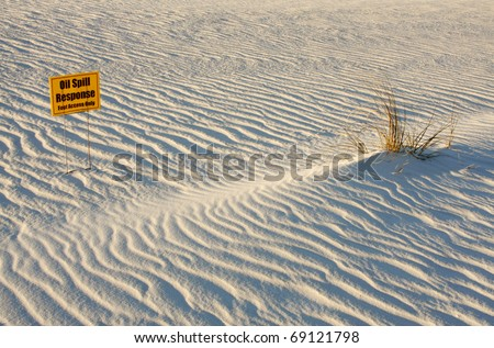 White Sands of the Gulf Coast with BP Oil Clean Up Sign - stock photo