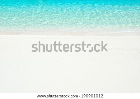 White sandy beach waves background  - stock photo