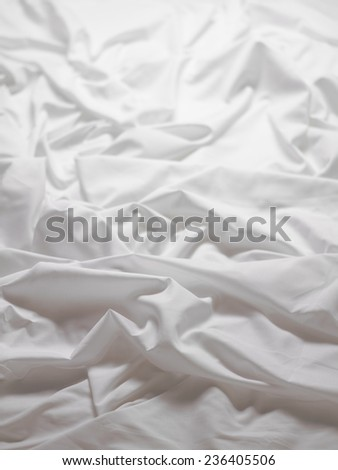 white satin sheets with a ripple background image