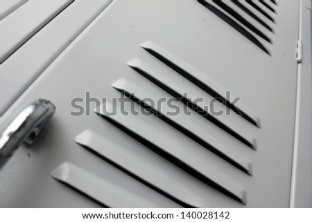 white school lockers with close up of louvers - stock photo