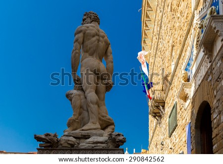 White sculpture Hercules and Cacus by  Baccio Bandinelli on  Piazza della Signoria in Florence at day, back view, Italy - stock photo
