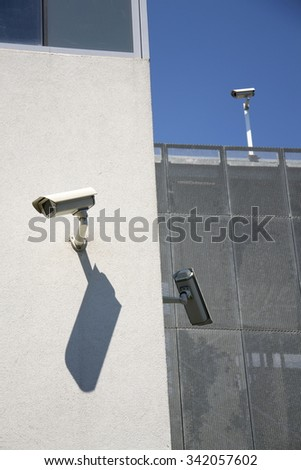 White security cameras on white wall