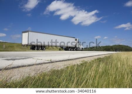 White Semi on the road - stock photo