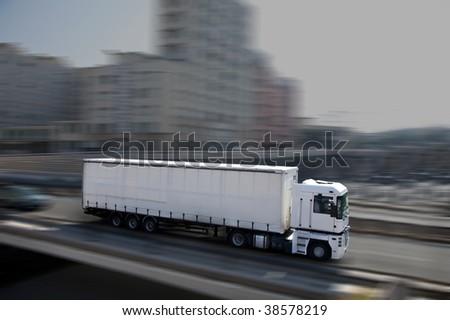 white semi-truck in town - stock photo