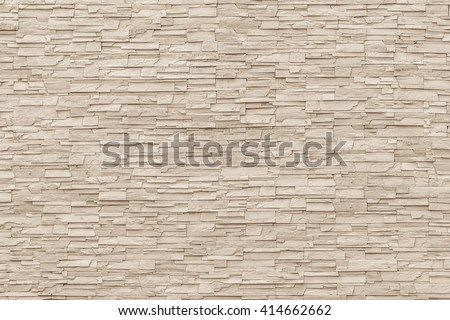 White sepia tan brown rock stone brick tile wall aged texture detailed pattern background: Grunge ancient rustic limestone stonework block masonry patterned backdrop for architectural decoration   - stock photo