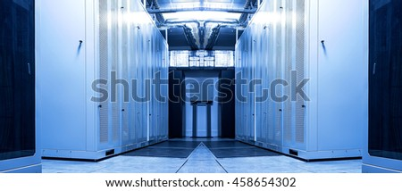 White Server Room Network/communications cluster in a mainframes room. - stock photo