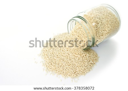 white sesame seed in jar on white background - stock photo