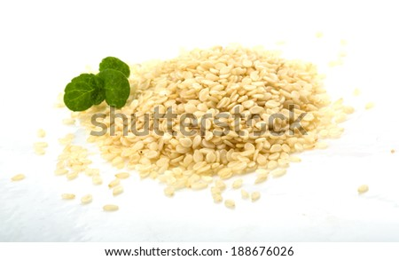 White sesame seeds with mint leaves - stock photo