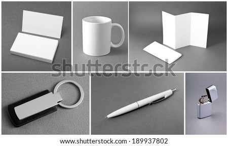 White set of stationery on gray background - stock photo