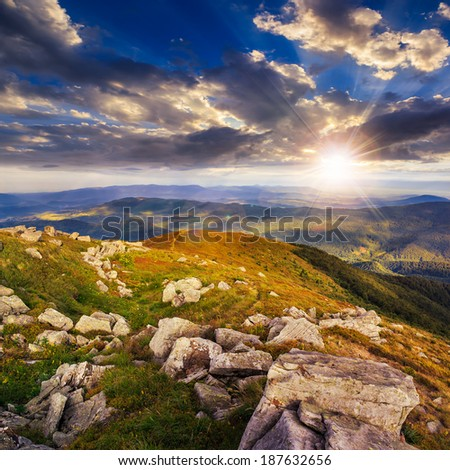 white sharp stones on the hillside at sunset - stock photo