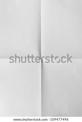 white sheet of paper folded in four.isolated on black - stock photo