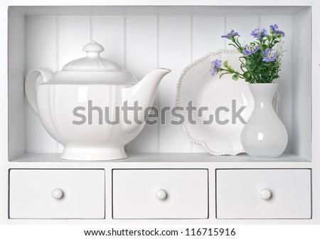 White shelf with vintage porcelain tableware - stock photo