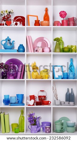 White shelves with colorful things in room - stock photo