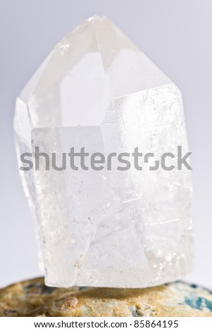 white shining rock mountain crystall quarz on white ground - stock photo