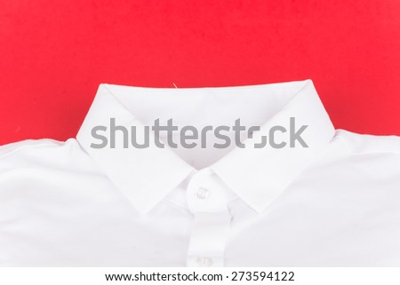 white shirt on red background - stock photo