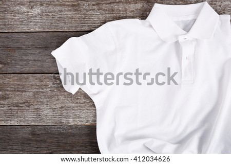 White shirt on the wooden table - stock photo