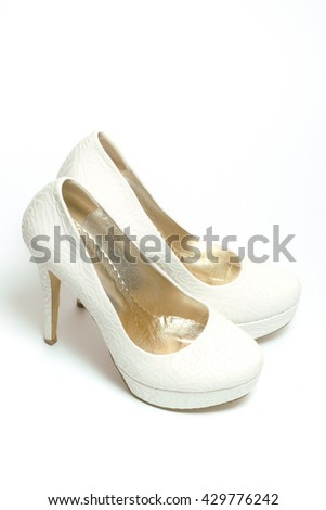 White shoes of bride beautiful high heel wedding pair for woman isolated - stock photo