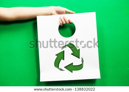 white shopping bag recycle symbol with hand - stock photo