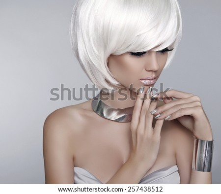 White Short Hair. Fashion stylish blond girl model. Haircut. Hairstyle. Fringe. Glamour woman Isolated on grey Background.  - stock photo