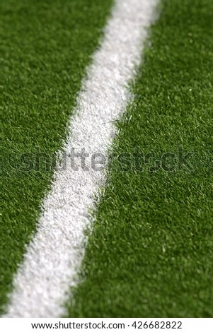 white side markings on the football field close up view